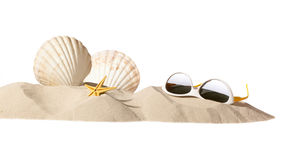 Shell and sunglasseson beach. Shell and sunglasses on beach, isolated on a white background,with a lot of copy-space Royalty Free Stock Photography