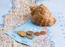 Shell, tickets and coins on the map. Royalty Free Stock Image