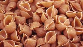 Pasta from polby bulk. Shell wholemeal spelled flour in bulk stock footage