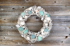 Shell wreath on aged wood Royalty Free Stock Photography