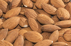 Shelled almonds closeup, background Stock Image