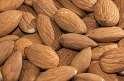 Shelled almonds closeup, background Stock Photos
