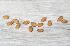Shelled almonds. Some shelled almonds on a wooden table royalty free stock photos