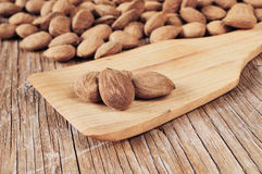 Shelled almonds on a wooden table Stock Image