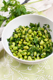 Shelled edamame beans with parsley Stock Images