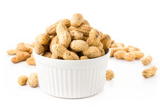 Shelled great peanuts in a bowl on white background, closeup Royalty Free Stock Image
