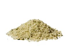 Shelled hemp seeds. On white background. Clipping path Stock Image