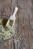 Shelled hemp seeds on table wood Stock Photo