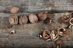 Shelled nuts on a wooden background Stock Images