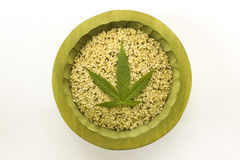 shelled organic hemp seeds green cannabis leaf wooden bowl Stock Images