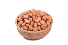 Shelled peanuts in brown cup. Isolated on the white background Royalty Free Stock Photography