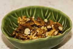 Shelled pecans in beautiful textured bowl royalty free stock photos