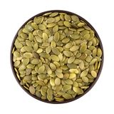 Shelled pumpkin seed in the bowl Royalty Free Stock Photography