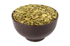 Shelled pumpkin seed in the bowl Stock Photo