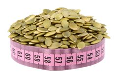 Shelled pumpkin seed and meter Royalty Free Stock Images