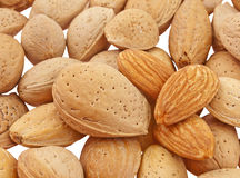 Shelled and unshelled almonds Royalty Free Stock Photos