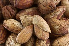 Shelled and unshelled almonds Royalty Free Stock Photo