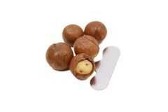 Shelled and unshelled macadamia nuts. Shelled and unshelled macadamia nuts Royalty Free Stock Images