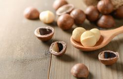 Macadamia nuts on old wood background. Shelled and unshelled macadamia nuts on old wood background Stock Photography