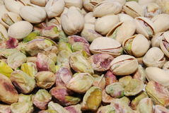 Pistachios. Shelled and unshelled pistachios stock images