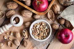 Shelled and unshelled walnuts on a wooden table, top view Stock Photos