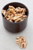 Shelled walnuts in a brown dish Royalty Free Stock Images