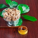 Shelled walnuts. In the dessert and green leaves Stock Image