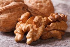 Shelled walnuts and walnut in the shell macro Royalty Free Stock Photos