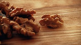Shelled walnuts on a wooden table Royalty Free Stock Photography
