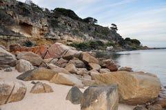 Shelley Cove: Orange Granite and Limestone Cliffs Stock Image