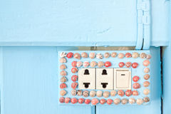 Shellfish on electric switch Stock Photography