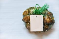 Shellfish enamel venus shell Seafood Clams on net bag in supermarket stock image