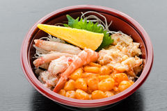 Shellfish Lover Donburi. On black reflective wood surface Royalty Free Stock Photos
