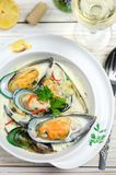 Shellfish mussels in cream sauce with white wine and chili pepper. Stock Photo
