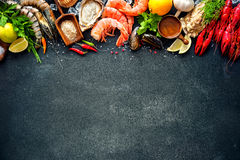 Shellfish plate of crustacean seafood. With shrimps, mussels, oysters as an ocean gourmet dinner background stock photography