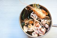 Shellfish seafood plate with shrimps prawns mussel squid ocean gourmet dinner seafood. Cooked boiled in hot pot royalty free stock images
