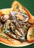 Shellfish soup. Sea-food shellfish soup and roasted bread Royalty Free Stock Images