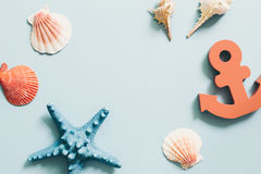 Shellfish and starfish and anchor on blue background, summer marine decoration Royalty Free Stock Photos