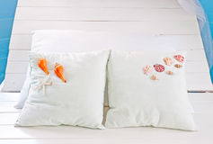 Shellfish with white pillow on the bed Stock Photos