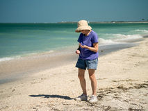 Shelling on Captiva and Sanibel Islands Florida Stock Photos