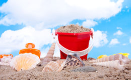 Shells And Plastic Beach Toys Royalty Free Stock Image