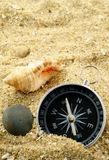 Shells and compass Royalty Free Stock Images