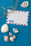 Shells and envelope on blue. Shells and air mail envelope on blue background Stock Photos