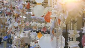 Shells hanging on string and glowing sunlight. HD stock footage