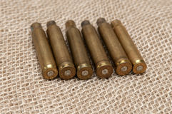 Shells of live ammunition on the background fabric. Stock Photos