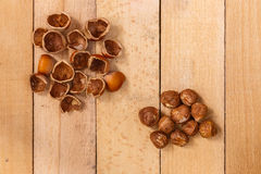Shells of nuts and nuts on the wooden board Stock Photos