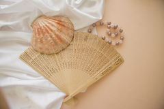 Shells and pearls on pink background. Spa concept background in pink and beige colors Stock Images