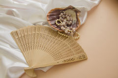 Shells and pearls on pink background. Spa concept background in pink and beige colors Stock Image