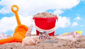 Shells and plastic beach toys Royalty Free Stock Photography