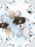 Shells and ring 4. Pattern of shells on white-blue background Stock Photography